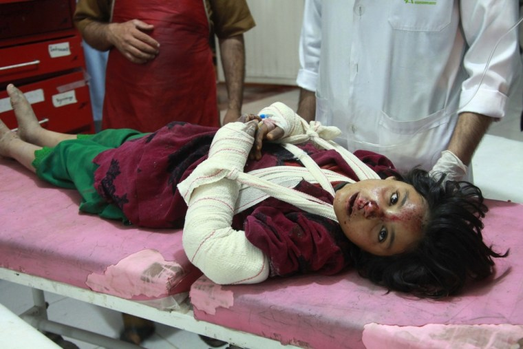 An injured Afghan girl is treated at a hospital after a roadside bomb in Afghanistan's capital city, Kabul.