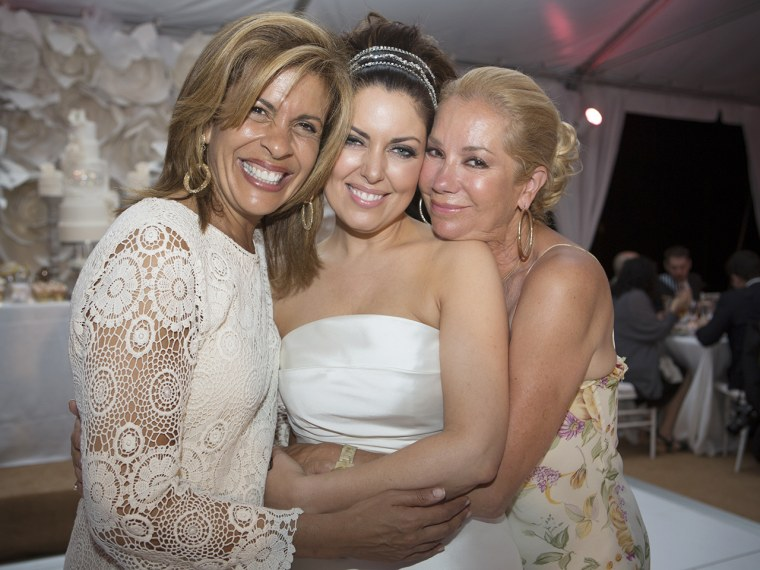 Hoda Kotb, Bobbie Thomas and Kathie Lee Gifford embrace on the reception dance floor.