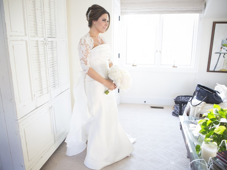 Bobbie Thomas poses in her Le Spose di Gio gown before the start of the wedding.