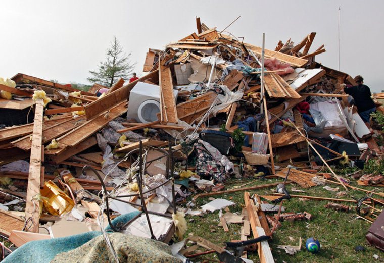 The remains of the house owned by Scott and M'Lynn McCann that was destroyed by a tornado west of El Reno, Okla., are shown Tuesday, May 24, 2011. Aut...