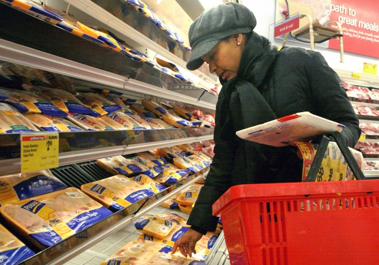 Carla Chery illustrates how she shops on a budget at her neighborhood supermarket in New York, Friday March 13, 2009.  Chery, a stay-at-home mom who n...