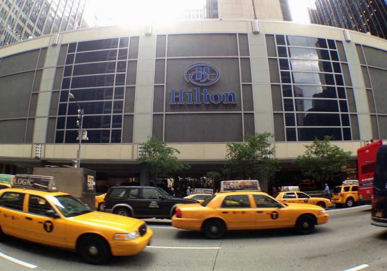 Taxis pass the New York Hilton Midtown on June 3, 2013. The biggest hotel in New York City is halting room service.