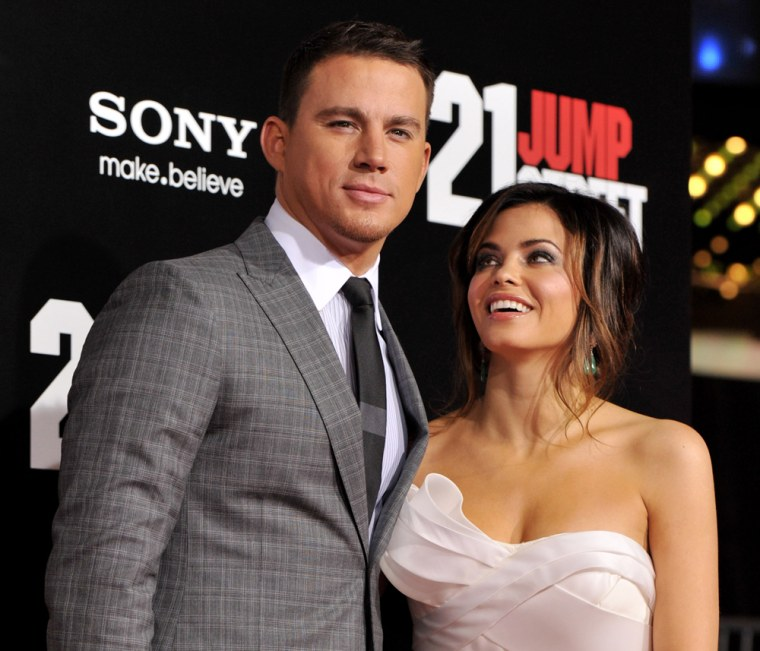 """LOS ANGELES, CA - MARCH 13:  Actors Channing Tatum (L) and his wife Jenna Dewan arrive at the premiere of Columbia Pictures' """"21 Jump Street"""" at the G..."""