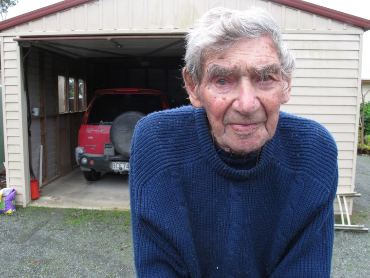 In this Sunday, May 26, 2013 photo, New Zealand's oldest driver Bob Edwards stands in front of his red Mitsubishi in Ngataki, New Zealand. Edwards, 10...