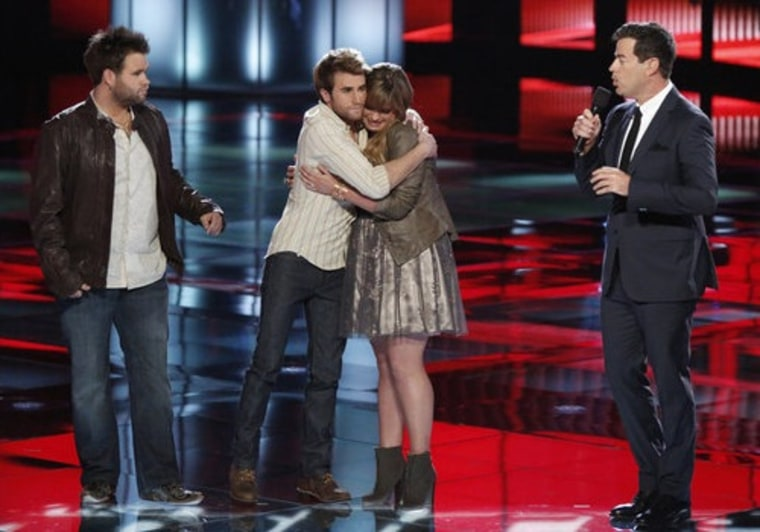 """The Swon Brothers comfort Holly Tucker after host Carson Daly announced the results on \""""The Voice\"""" Tuesday night."""