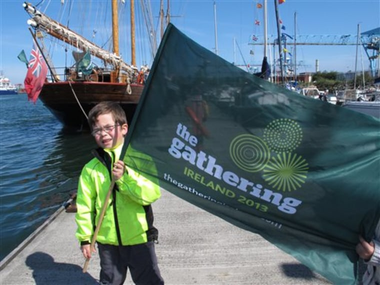 This May 17, 2013 photo shows 5-year-old Callum MacCobb posing with his flag on Dublin docks as he greeted the tall ships sailing into the port. The s...