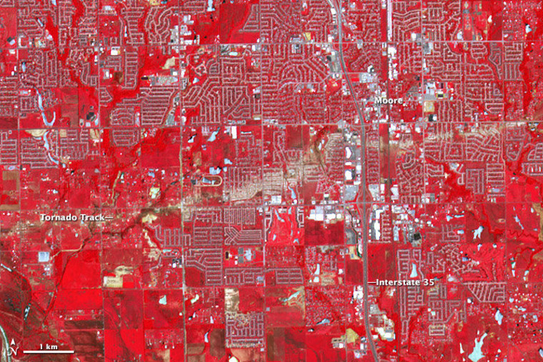 The ASTER instrument on NASA's Terra satellite captured this false-color image of Moore, Okla., on June 2, two weeks after a powerful tornado swept through. The scar left by the tornado can be seen as a brownish streak slashing across the image.