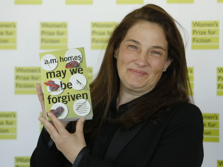 """A.M. Homes, author of \""""May We Be Forgiven\"""", poses for photographers before the announcement of the  2013 Women's Prize for Fiction at the Royal Festiv..."""