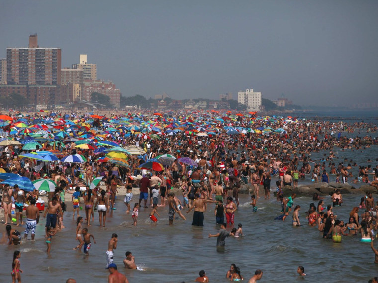 People crowd at the beach at Coney Island in Brooklyn, New York, on June 30, 2012, as heat waves and thunderstorms hit the eastern United States