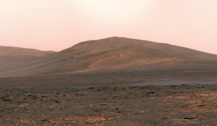 This panorama from NASA's Opportunity rover, made on June 1, shows Solander Point rising up on the Martian horizon. Mission managers plan to get the solar-powered rover to a north-facing slope on Solander Point by August, so that it can shelter there during the Martian winter.