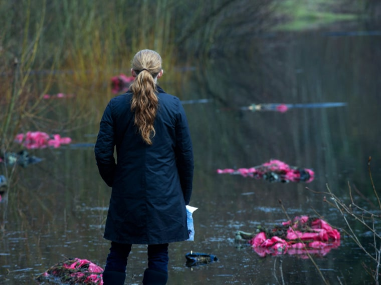 Linden (Mireille Enos) looks out at the bags of bodies.