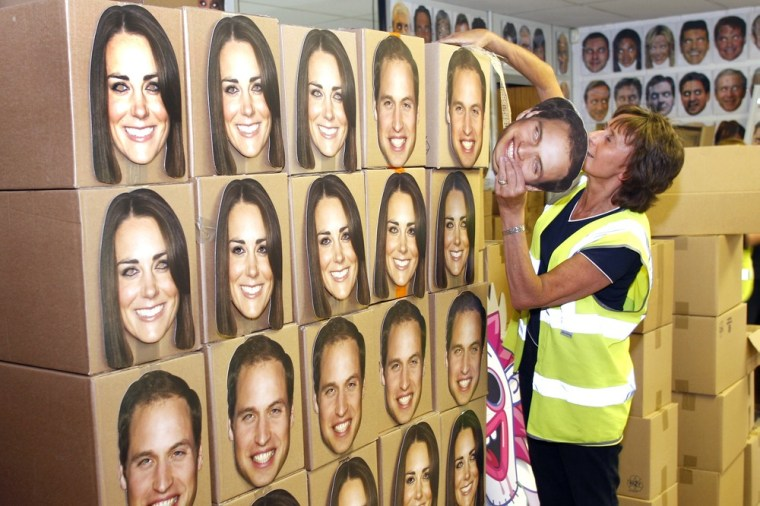 Pam Cooper from the Mask-arade mask company loads boxes of Prince William and Kate, Duchess of Cambridge masks ready for dispatch at the company works...