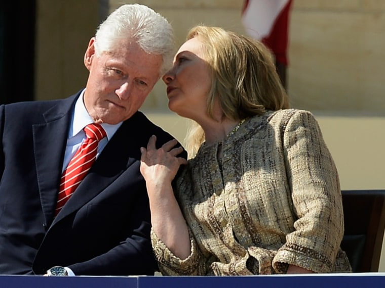 Former first lady and former Secretary of State Hillary Rodham Clinton speaks with her husband former president Bill Clinton as they attend the opening ceremony of the George W. Bush Presidential Center April 25, 2013 in Dallas, Texas.