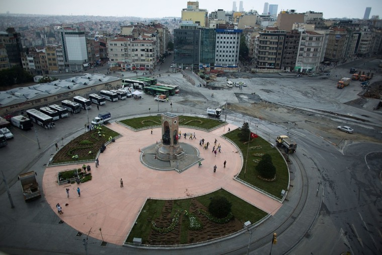 Workers clean Taksim Square after the crackdown action in Istanbul, Turkey. Istanbul has seen protests rage on for days.