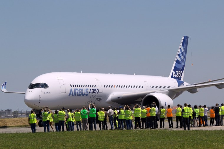 The Airbus A350 lands after its maiden flight at Blagnac airport near Toulouse, southwestern France, Friday, June 14, 2013.