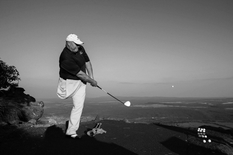 Single leg amputee Glenn Mackintosh from South Africa drives a ball off the extreme 19th tee from Hanglip mountain 430 yards above the green during the Nedbank South African Disabled Golf Open at Legends Golf course in Limpopo, South Africa on May 14.