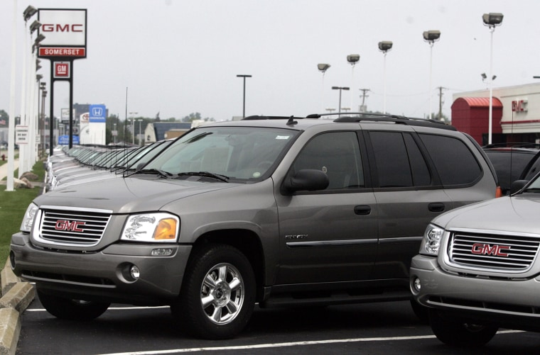 A Line Of Gmc Envoy Suv S Sit For At Car Lot In Troy