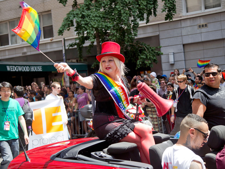 NEW YORK, NY - JUNE 24: Musician Cyndi Lauper takes part in the 2012 Gay Pride Parade in New York City on June 24, 2012. She is also taping her show C...