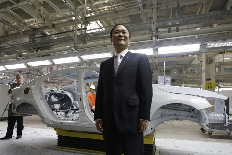 Chairman of Zhejiang Geely Holding Group Li Shufu poses for a photo at an assembly line of the new Volvo automobile manufacturing plant in Chengdu, Si...