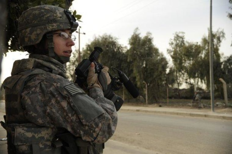 Former Air Force videographer Adrienne Brammer in Mosul, Iraq, in 2008 where she was attached to U.S. Army infantry units and found herself in