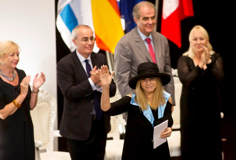 Singer Barbra Streisand waves after receiving a honorary Doctor of Philosophy degree from the Hebrew University in Jerusalem on Monday.