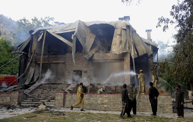 Pakistani firefighters extinguish a blaze which gutted a historical building in Ziarat, about 50 miles southeast of Quetta, on Saturday. The country's founding father Mohammad Ali Jinnah spent his last days in the building, which was declared a national monument following his death, one year after Pakistan's independence in 1947.