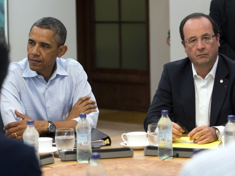 President Barack Obama, left, and French President Francois Hollande attend a round table meeting of G-8 member countries at the G-8 Summit at the Lough Erne golf resort in Enniskillen, Northern Ireland, on Tuesday, June 18, 2013.