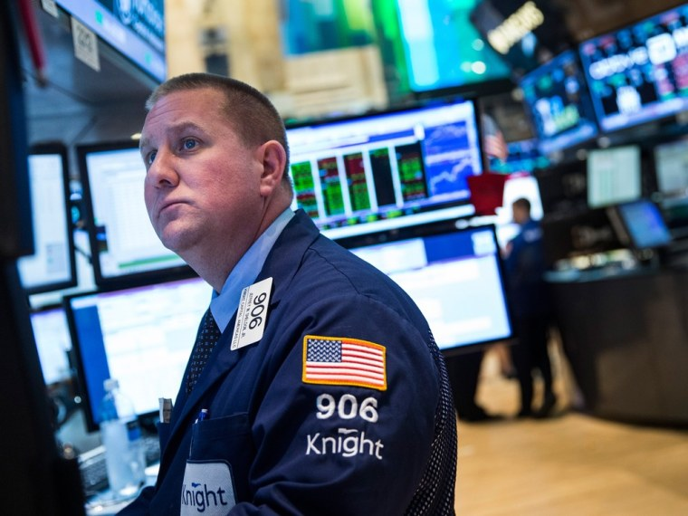 NEW YORK, NY - JUNE 18:  A trader works on the floor of the New York Stock Exchange on June 18, 2013 in New York City. 2013 U.S. Open winner Justin Ro...