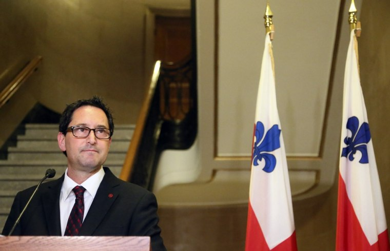 Montreal mayor Michael Applebaum announces his resignation during a news conference in Montreal, Quebec, on June 18. Applebaum was arrested at his home Monday morning and was charged with 14 offenses including breach of trust and fraud.