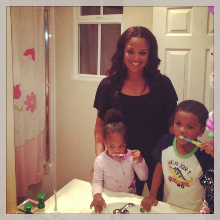 Laila Ali teaching her children Sydney and Curtis to brush properly.
