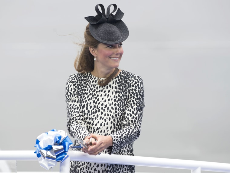 SOUTHAMPTON, ENGLAND - JUNE 13:  Catherine, Duchess of Cambridge smashes a bottle of Champagne during the Princess Cruises ship naming ceremony at Oce...