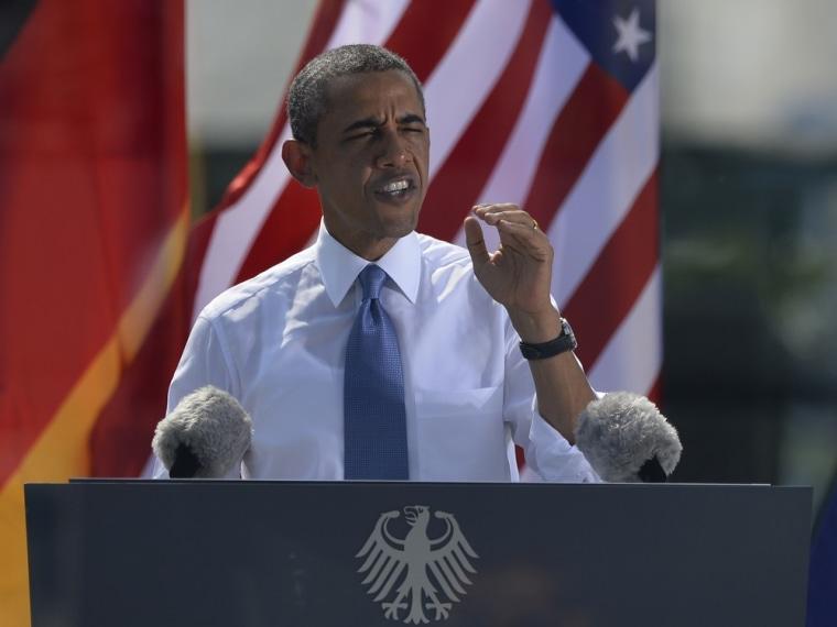 President Barack Obama gives a speech on a podium in front of Berlin's landmark the Brandenburg Gate near the U.S. embassy on June 19, 2013.