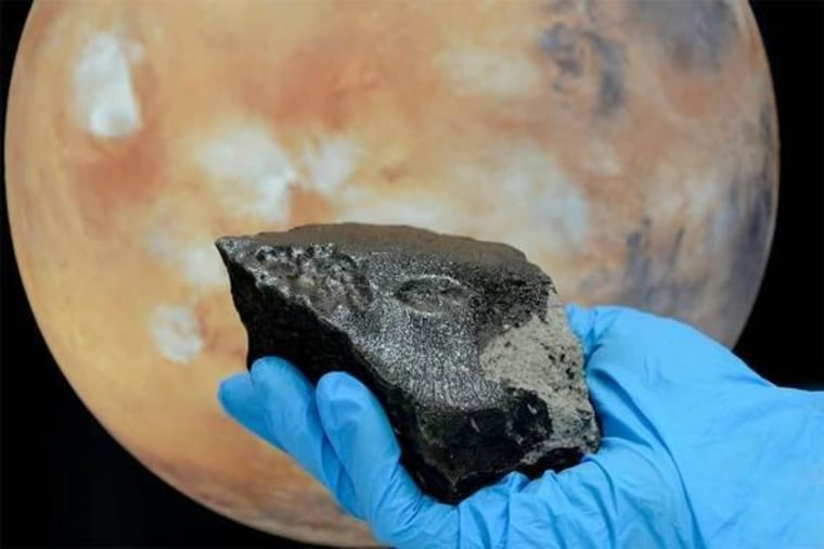 The rear of the stone from the Tissint Martian meteorite is almost completely covered with a glossy black fusion crust.
