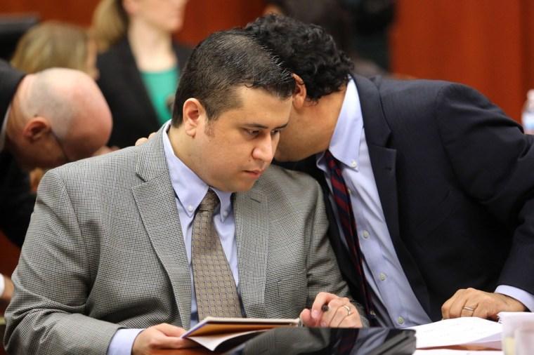 George Zimmerman, left, listens to jury consultant Robert Hirschhorn in Seminole circuit court on June 19, in Sanford, Fla.