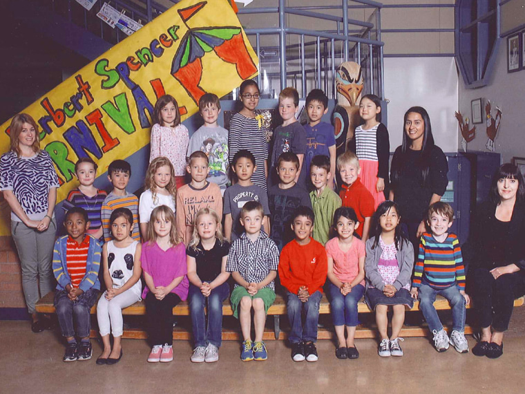 The second photo taken of Miles Ambridge's class, where the 7-year-old sits on the far right of the front row bench.