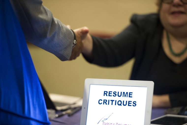 In this Thursday, May 30, 3013 photo, a job seeker stops at a table offering resume critiques during a job fair held in Atlanta.