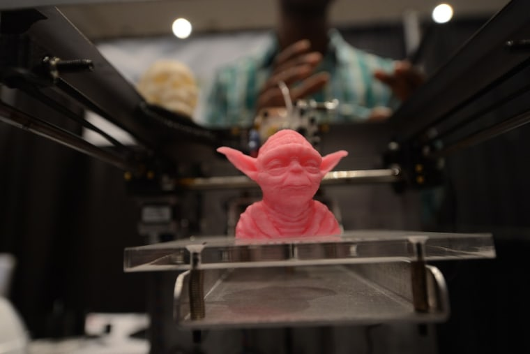 A sample object, printed with a 3D printer, is displayed during the