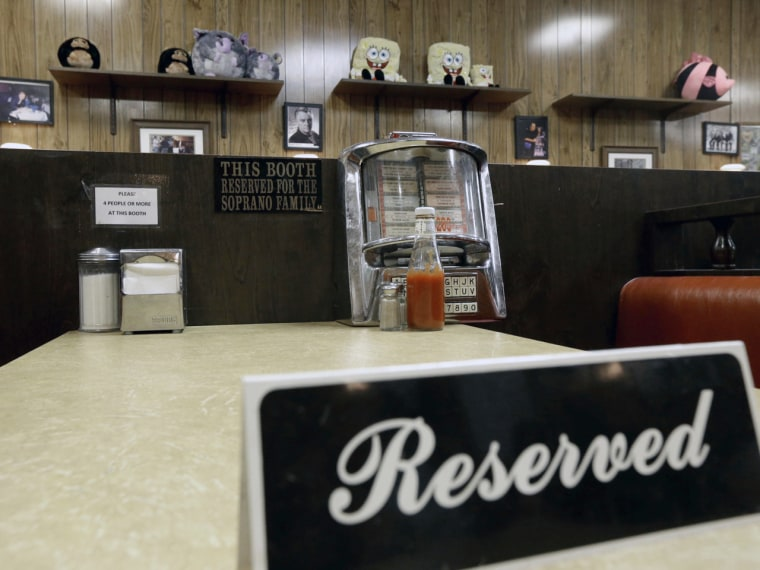 """Image: A reserved sign sits on the booth where the last show of the HBO series """"The Sopranos"""" was filmed at Holsten's ice cream parlor."""