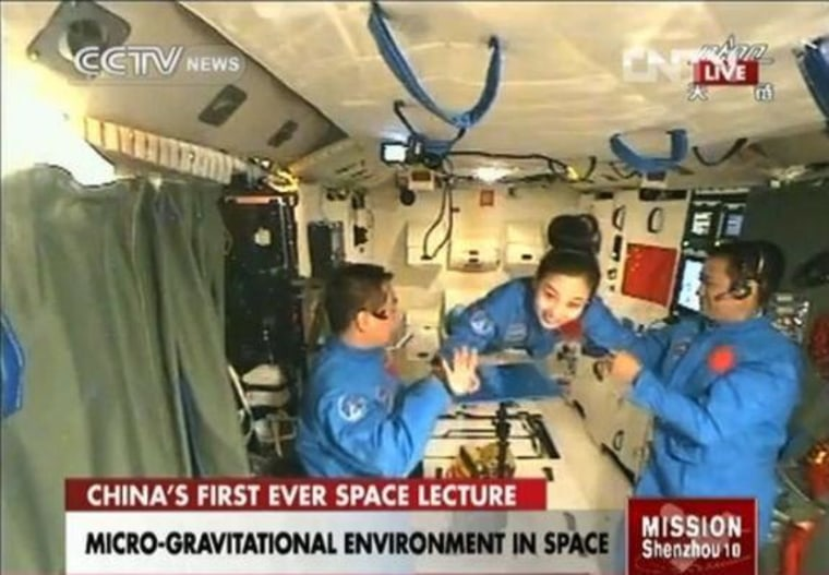 A video screengrab shows the Chinese astronauts aboard space station Tiangong-1 as they prepare for the space lecture to be delivered by Wang Yaping on Thursday.