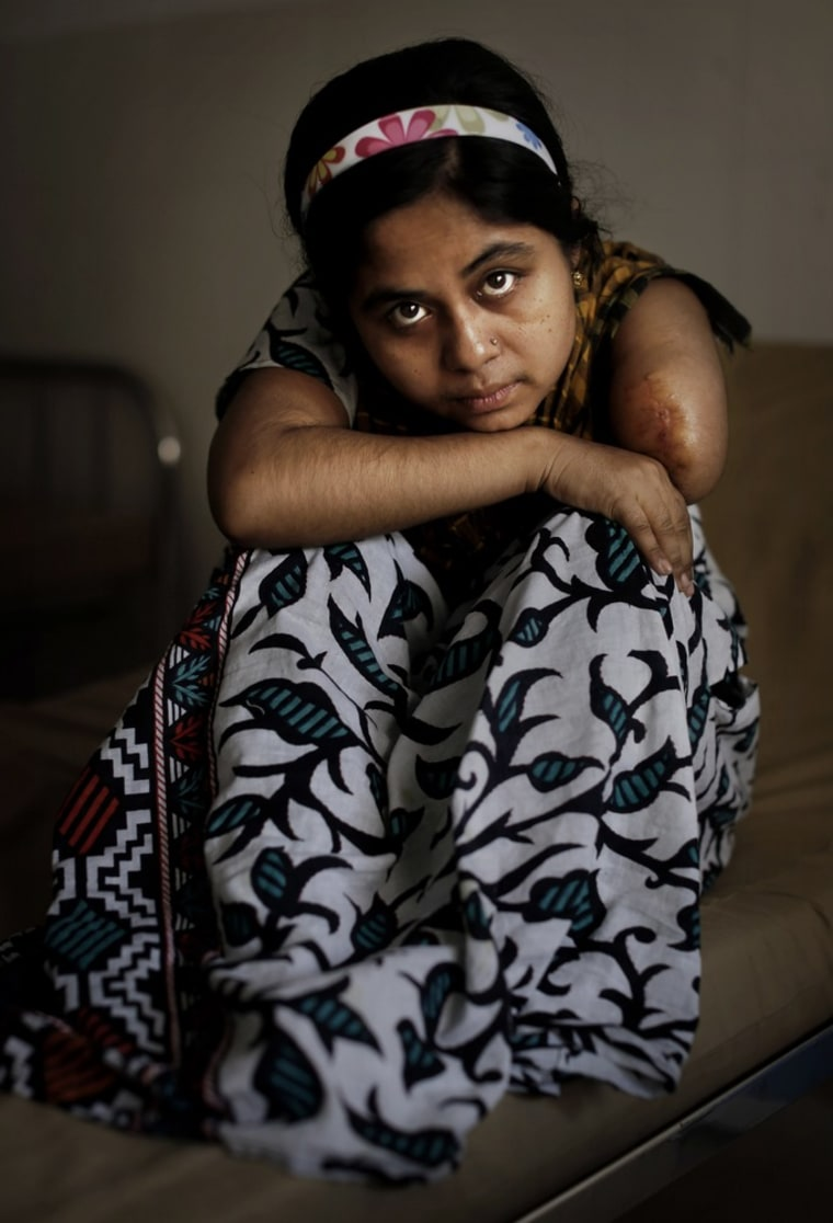 Bangladeshi garment worker Laboni, 21, worked on the 4th floor of Rana Plaza. She had her left amputated inside the rubble when she was rescued nearly 36 hours after the building collapsed.