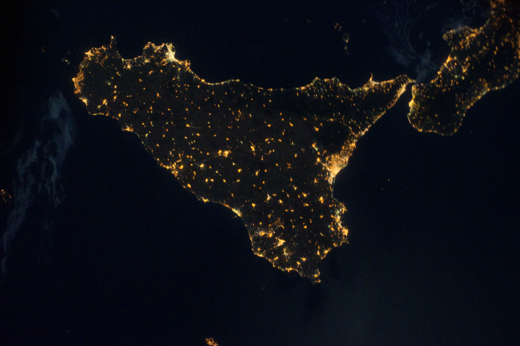 """A picture taken from the International Space Station on Aug. 18 shows Sicily and the toe of Italy's """"boot"""" at night, from a height of 220 miles."""
