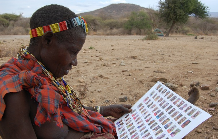 A woman from Tanzania's Hadzabe tribe studies a social-networking chart.