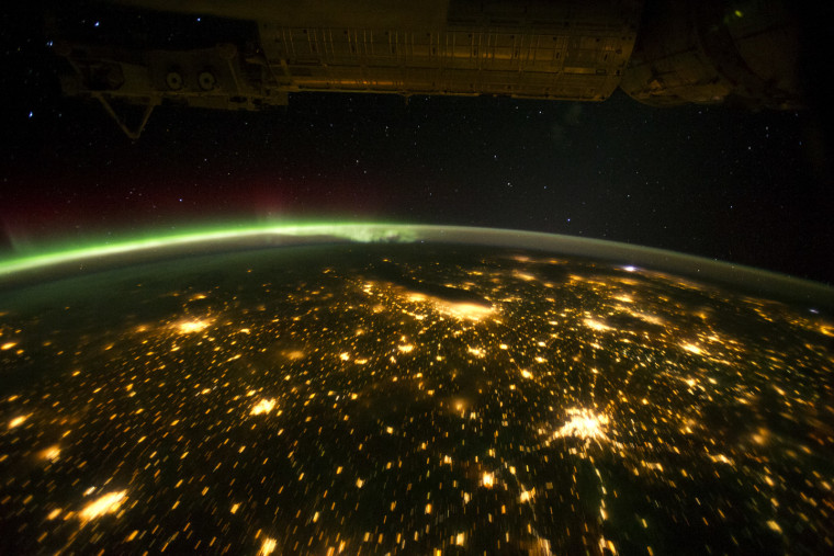 This greenish auroral display was seen from the International Space Station on Sept. 29 as the orbital outpost was passing over the American Midwest. The city lights of Omaha, Des Moines, Minneapolis/St. Paul, Chicago and St. Louis are visible below.
