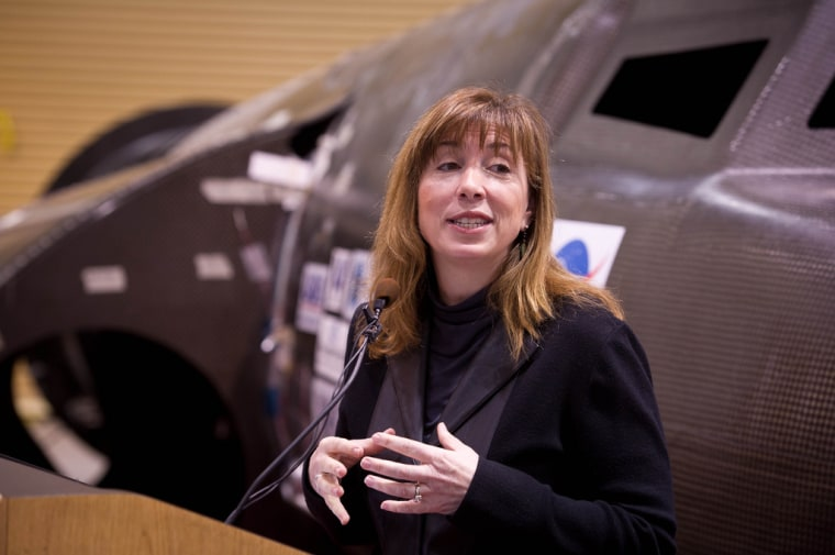 NASA Deputy Administrator Lori Garver, seen here during a February news conference with Sierra Nevada Corp.'s Dream Chaser spaceship, says providing funds for U.S. spaceship developers now will reduce payments to the Russians later.