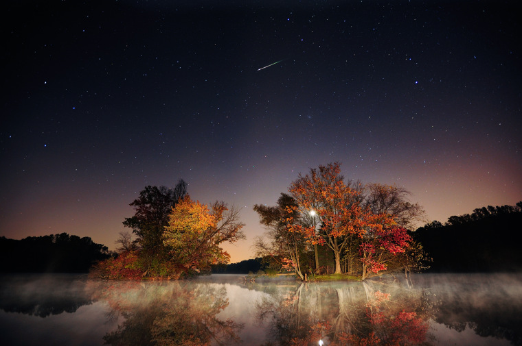 Photographer Jeff Berkes' picture of an Orionid meteor streak over Elverson, Pa., also features autumn leaves.