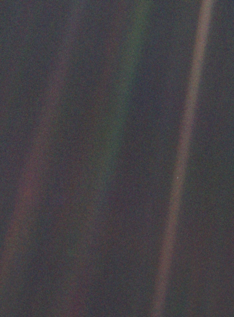 NASA's Voyager 1 spacecraft made this image of Earth -- the dot at center right -- when it was 4 billion miles away. The image was requested by Carl Sagan, who died on Dec. 20, 1996.