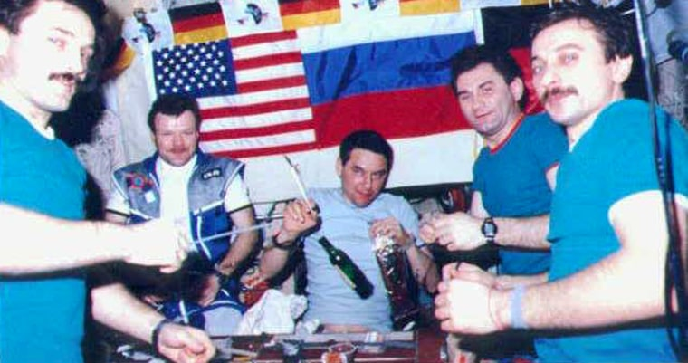 Cosmonauts gather to have some cognac on the Mir space station in 1997, hours after a flash fire nearly killed them. Alexander Lazutkin is at far right. The picture was taken by NASA astronaut Jerry Linenger, who passed up the opportunity to imbibe.