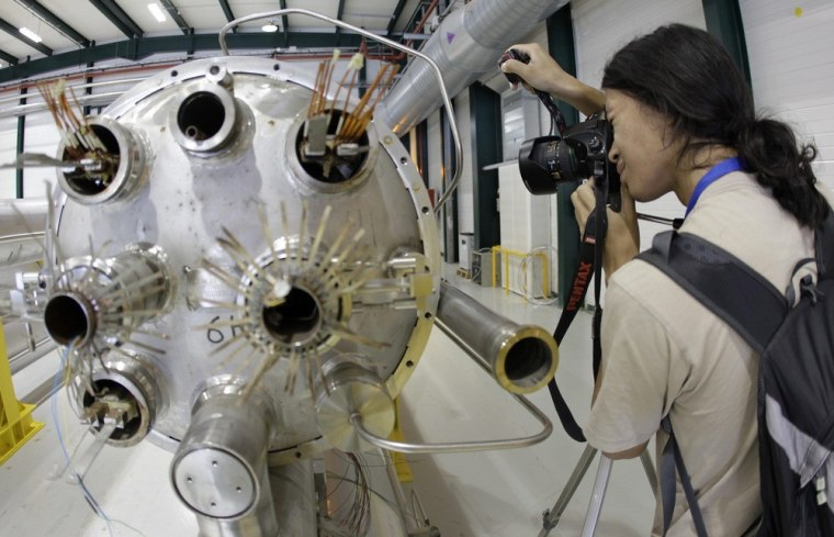 An amateur photographer takes a picture of elements of the Large Hadron Collider during this month's Particle Physics Photowalk at Europe's CERN research center. The LHC has weathered technical glitches as well as legal challenges.