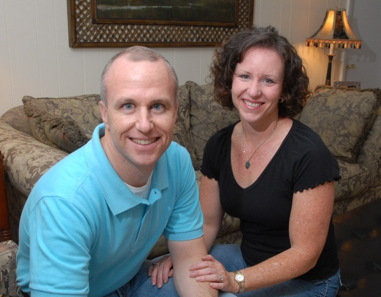 In this Thursday, May 11, 2006 file photo, Alan Chambers, left, president of Exodus International, sits with his wife, Leslie, in their home in Winter Park, Fla.