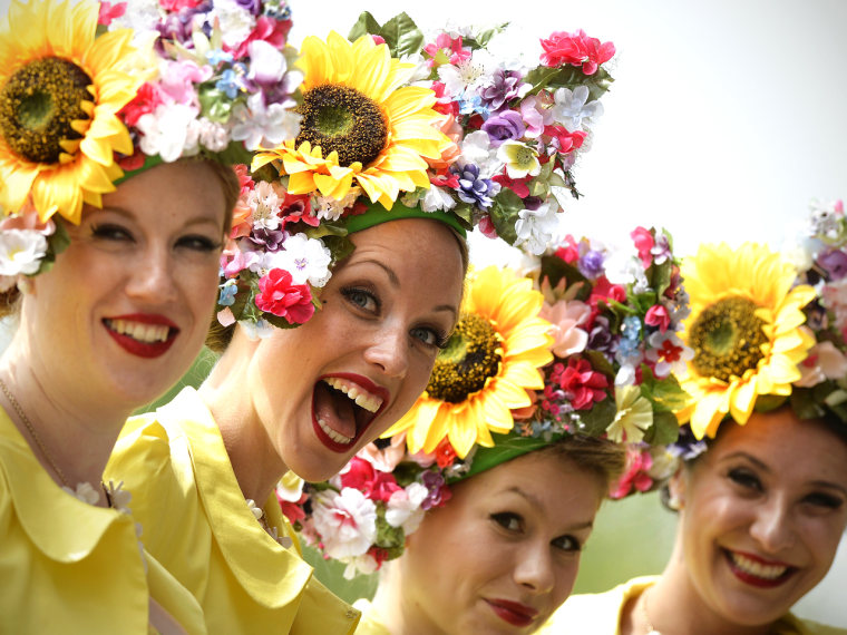 Members of The Tootsie Rolls, a retro girl band, pose for pictures during the second day of Royal Ascot, in Berkshire, west of London, on June 19, 201...